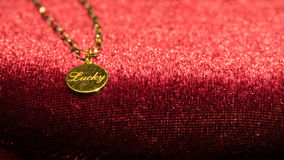 Gold pendant necklace Stock Photo