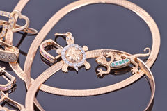 Gold pendants in the form of turtles and salamanders Stock Images