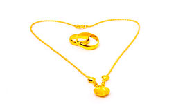 Gold pendants. Two gold rings  and gold necklace Stock Photography