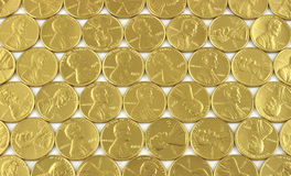 Gold pennies Stock Images