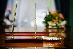 Gold pens Stock Images