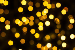 Gold pentagon bokeh Royalty Free Stock Images