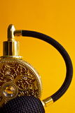 Gold perfume bottle. A close up shot of a gold luxury perfume bottle Stock Photography