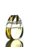 Gold Perfume Bottle isolated. Stock Image