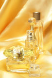Gold perfume bottles Royalty Free Stock Photo