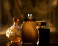 Gold perfume bottles Royalty Free Stock Photos