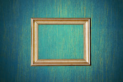 Gold photo frame on green wall Stock Photos