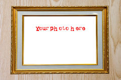 Gold photo frame on wood Stock Photography