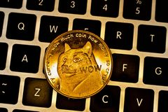 Gold physical dogecoin coin stock image