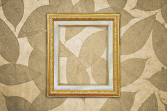 Gold Picture Frame on Brown Leaves Pattern Royalty Free Stock Images