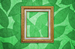 Gold Picture Frame on Green Leaves Pattern Royalty Free Stock Image
