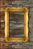 Gold Picture Frame on wood background, perfect mockup royalty free stock image