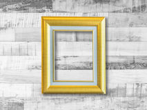 Gold picture frame on wooden plank wall Stock Photography