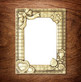 Gold picture frame on wooden wall Stock Images