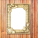 Gold picture frame on wooden wall Royalty Free Stock Image