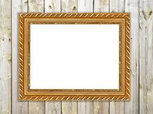 Gold picture frame on wooden wall Stock Photography