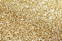 Gold pieces of confetti. Royalty Free Stock Images