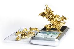 Golden nugget found by amateur prospector weighted on digital scale. Gold pieces and nuggets found by amaterur prospector weighted on digital scale Stock Photography