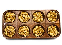 Gold Pieces In A Serving Tray Royalty Free Stock Photography