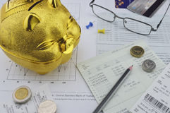Gold piggy bank, coin and pencil on saving account book Royalty Free Stock Images