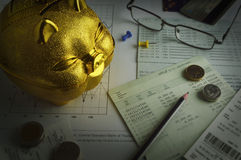 Gold piggy bank, coin and pencil on saving account book. Saving concept Royalty Free Stock Image