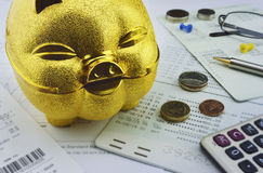 Gold piggy bank with coin on saving account book Stock Photos