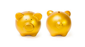 Gold piggy bank isolated on white background. File contains a clipping path Royalty Free Stock Images