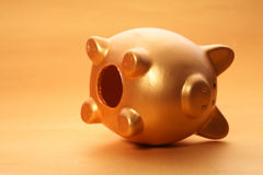 Gold piggy bank. On white background Royalty Free Stock Photos