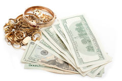 Gold pile scrap and cash dollar. Cash dollar for gold scrap royalty free stock photo