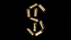Gold pills Stock Photography