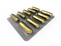 Gold Pills Stock Image