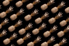 Gold pineapple slices on black background Royalty Free Stock Photos