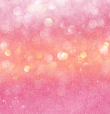 Gold and pink abstract bokeh lights. defocused background Royalty Free Stock Photo