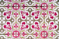 Gold and Pink Patterned Portuguese Tiles Stock Photo