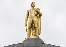 Gold pioneer statue atop the Oregon State Capitol Building royalty free stock photo