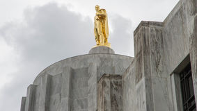 Gold pioneer statue atop the Oregon State Capitol Building royalty free stock image