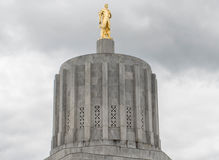 Gold pioneer statue atop the Oregon State Capitol Building royalty free stock photography