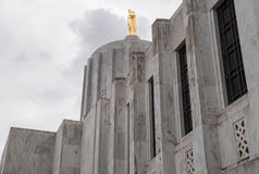 Gold pioneer statue atop the Oregon State Capitol Building stock image