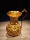 Gold pitcher Stock Images