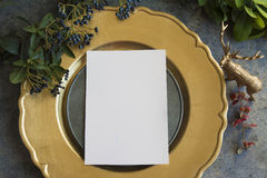 Gold place setting with empty menu on grunge. Gold place setting with empty white menu on grunge background Royalty Free Stock Photo