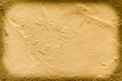 Gold plastered wall background Royalty Free Stock Image