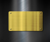 Gold plate or nameboard over black metal Stock Photography
