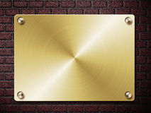 Gold Plate On Brick Wall Royalty Free Stock Images