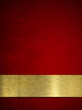 Gold plate or plaque on red background Royalty Free Stock Image