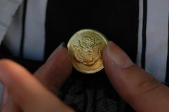 Gold Plated button. A fine gold plated button, decorative pattern, meaning auspicious Stock Image