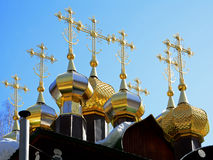 Gold-plated domes with crosses of wooden Russian Orthodox Christian Church of St. Nicholas in Ganina Yama Monastery. Stock Image