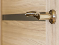 Gold-plated door handle Royalty Free Stock Photos