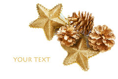 Gold plated pine cones and stars macro isolated Royalty Free Stock Photo