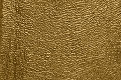 Gold-plated using computer processing photography background of artificial leather royalty free stock photo
