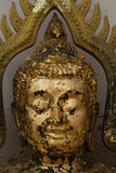 Gold plates on face buddha,The Buddha statue to gild with gold l. Eaf, Phichit, Thailand stock photos